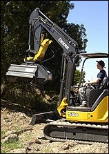 Mini excavator with mulcher